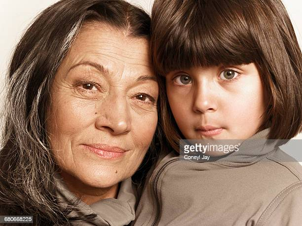 Young girl and older woman looking to camera