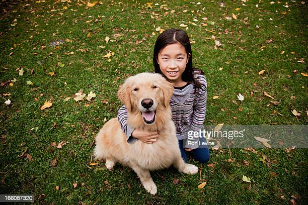 Young girl and pet golden retriever, portrait
