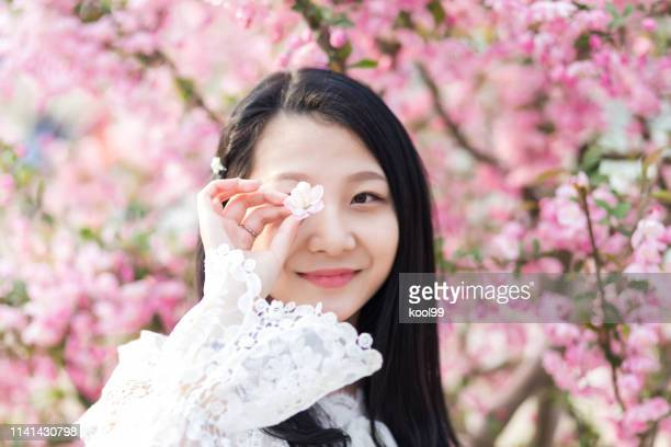 young girl and spring flowers - korean teen stock pictures, royalty-free photos & images