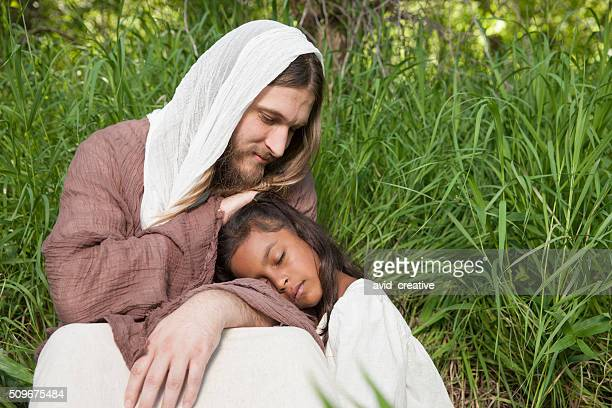 young girl asleep on jesus lap - smiling jesus stock pictures, royalty-free photos & images
