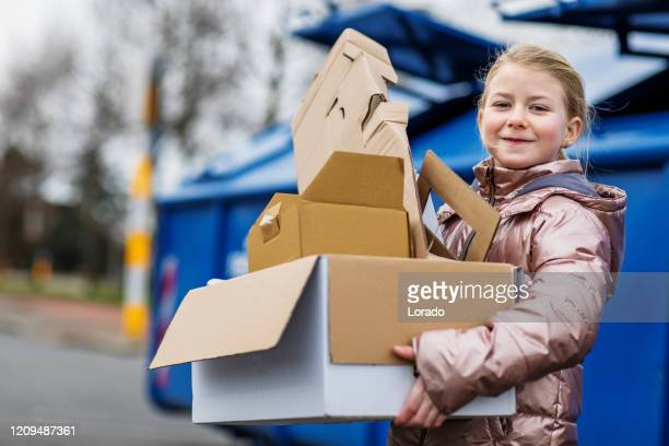 young girl at a paper recycling centre - recycling stock pictures, royalty-free photos & images