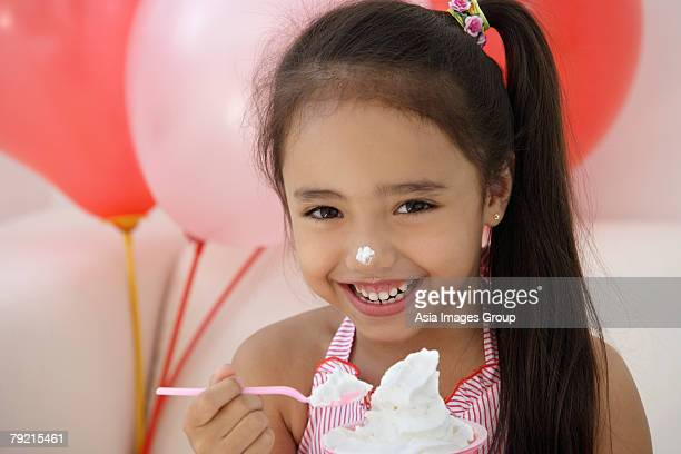 A young girl at a party with balloons