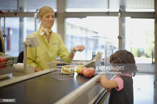 Young girl at grocery store check-out