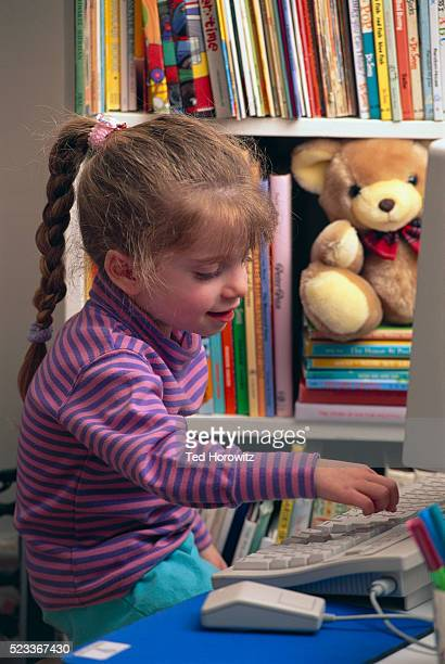 Young girl at home computer