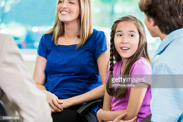 Young girl at meeting with family