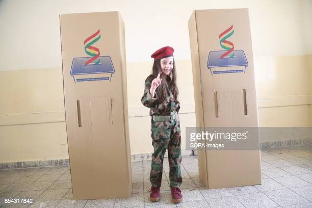 A young girl at polling station is pictured after she casted her vote at the voting station September 25 2017 is a historic day for Kurdish people...