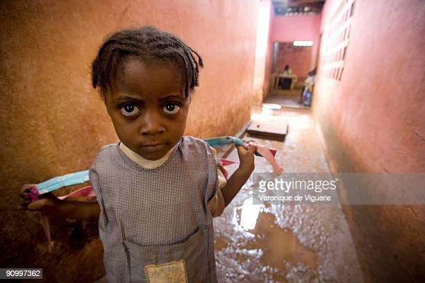 A young girl at school Her older sister is currently enduring breast ironing which she will also have to face in years to come In Cameroon there is a...