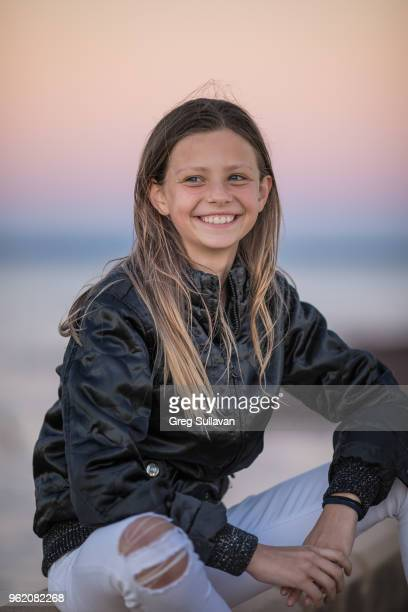 Young girl at the beach at sunset