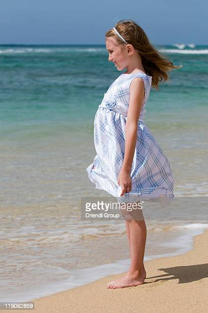 A young girl at the shoreline