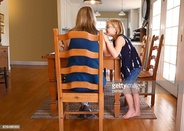 young girl attempting to get the attention of working mother - inconvenience stock pictures, royalty-free photos & images