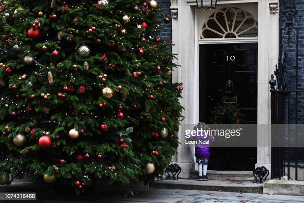A young girl attending Downing Street in connection with the Dreams Wishes charity waits by the front door of Number 10 on December 17 2018 in London...
