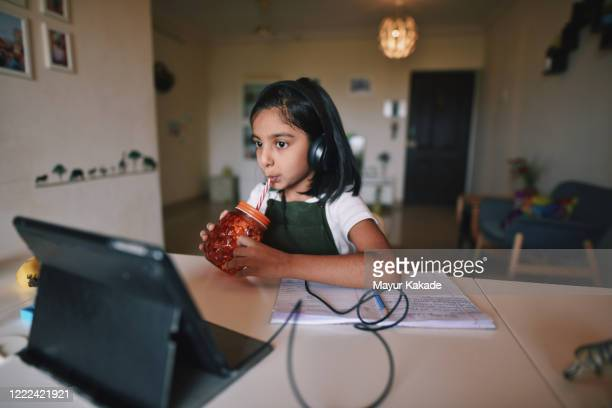 young girl attending online school - conference call stock pictures, royalty-free photos & images