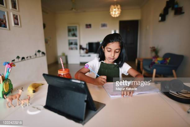 young girl attending online school - learning stock pictures, royalty-free photos & images