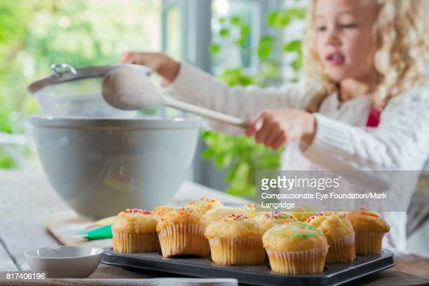 Young girl baking in kitchen