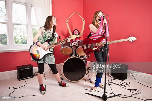 Young girl band playing at home