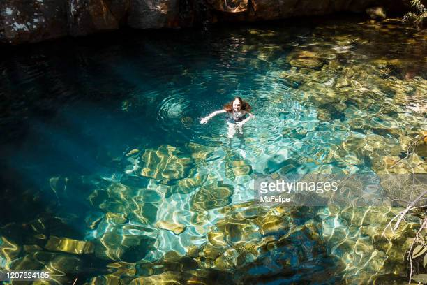 young girl bathing on a natural pool on a river in chapada dos veadeiros, goias, brazil - goias stock pictures, royalty-free photos & images
