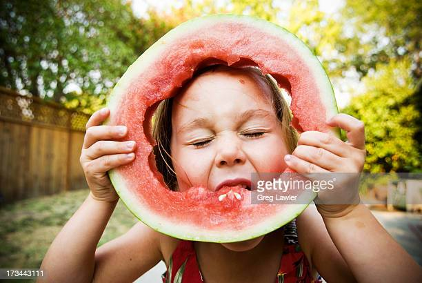 a young girl blissfully eating watermelon - naughty america stock pictures, royalty-free photos & images