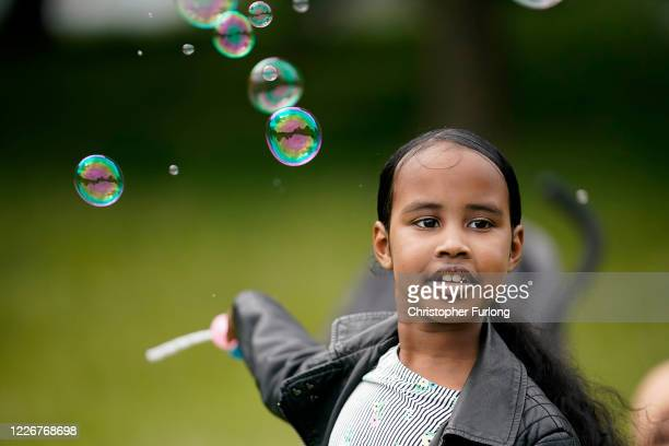 Young girl blows sopa bubbles in a near deserted Small Heath Park as the muslim community celebrate Eid under Covid-19 pandemic lockdown restrictions...