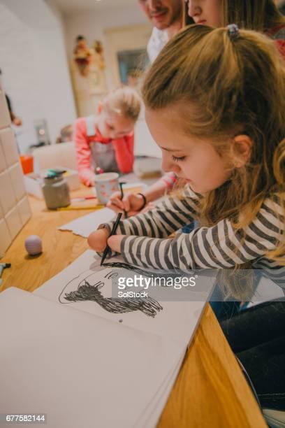 Young Girl Born Without Hands Drawing