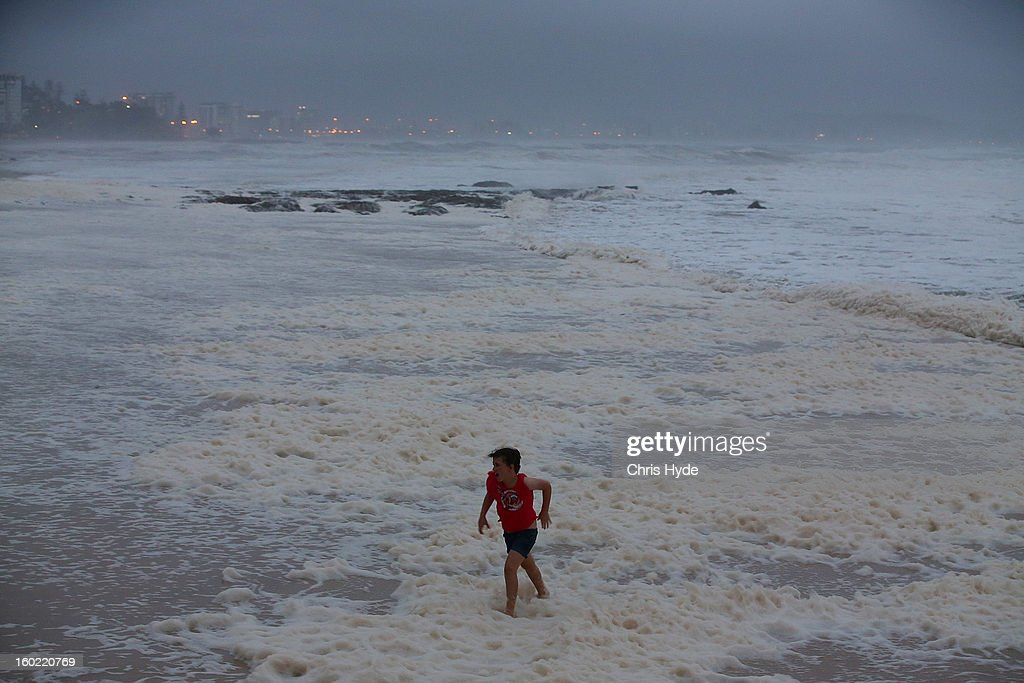 A young girl braves wild conditions in Snapper Rocks as Queensland experiences severe rains and flooding from Tropical Cyclone Oswald on January 28, 2013 in Gold Coast, Australia. Hundreds have been evacuated from the towns of Gladstone and Bunderberg while the rest of Queensland braces for more flooding.