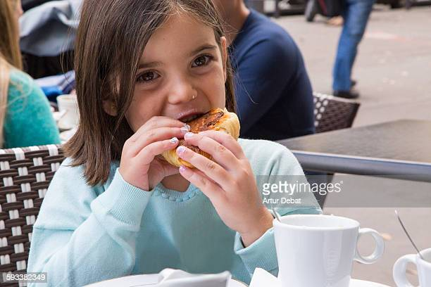 Young girl breakfast in a Paris terrace.