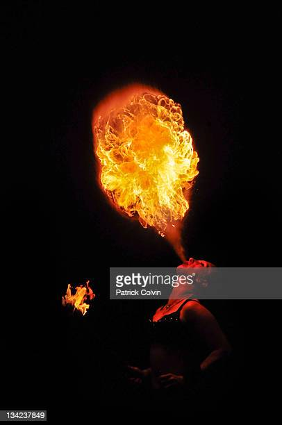 Young girl breathing out fireball