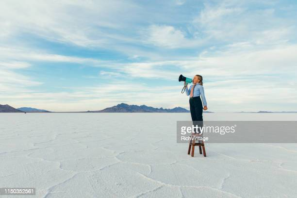 young girl businesswoman with megaphone - megaphone stock pictures, royalty-free photos & images