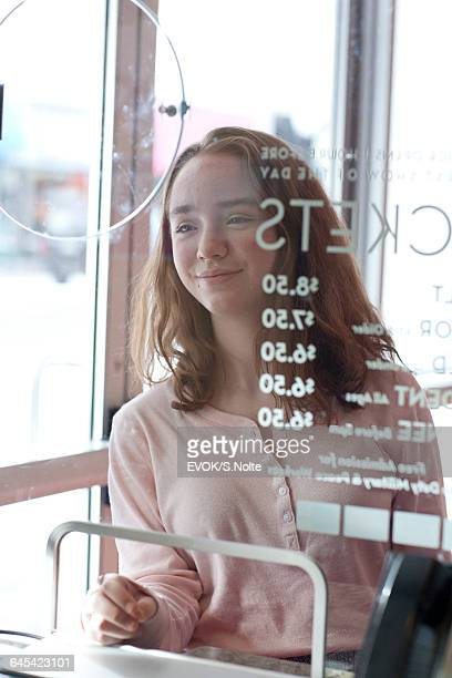 young girl buying a movie ticket at box office - hygiaphone photos et images de collection