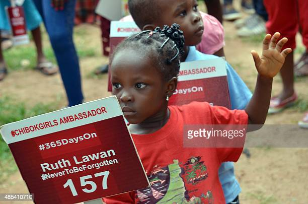 A young girl carries a placard with a name of a girl as family and friends mark 500 days since the abductions of Chibok schoolgirls by Boko Haram...
