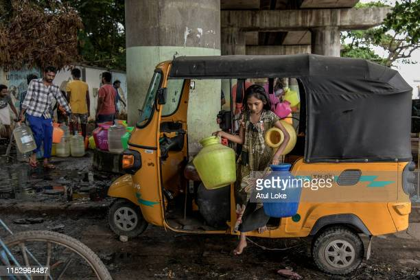 Young girl carries empty water cans for filling them at the Metro water filling station in the heart of the Chennai city on June 30, 2019. All the...