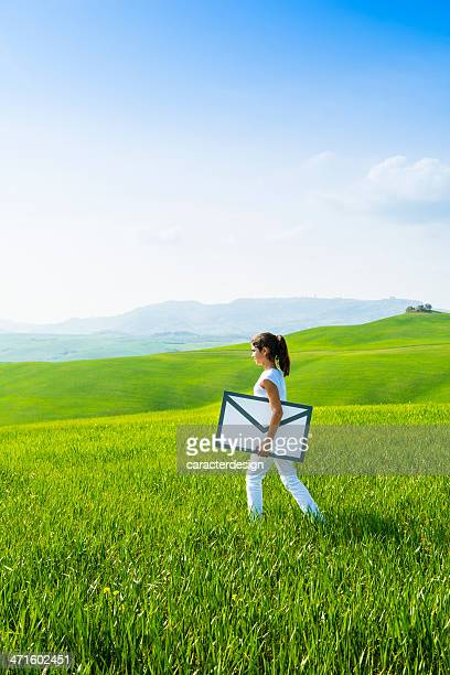 Young girl carrying envelope: e-mail concept