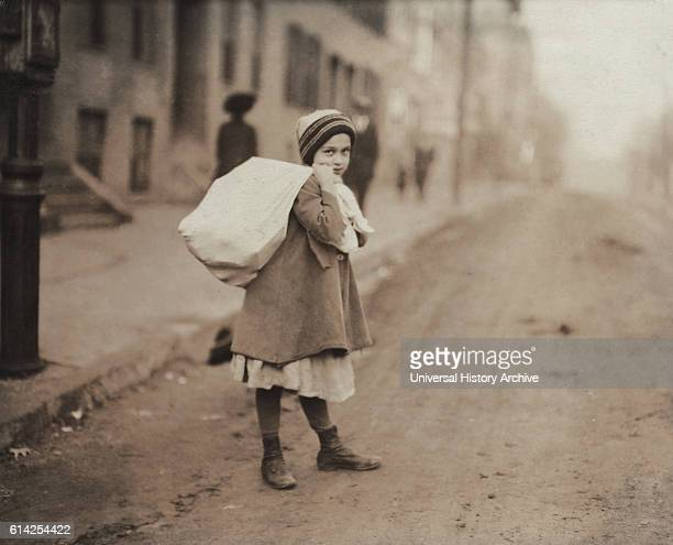 Young Girl Carrying Sack of Hosiery Supporters Home after Leaving Work and Before she Goes off to School Worcester Massachusetts USA circa 1912