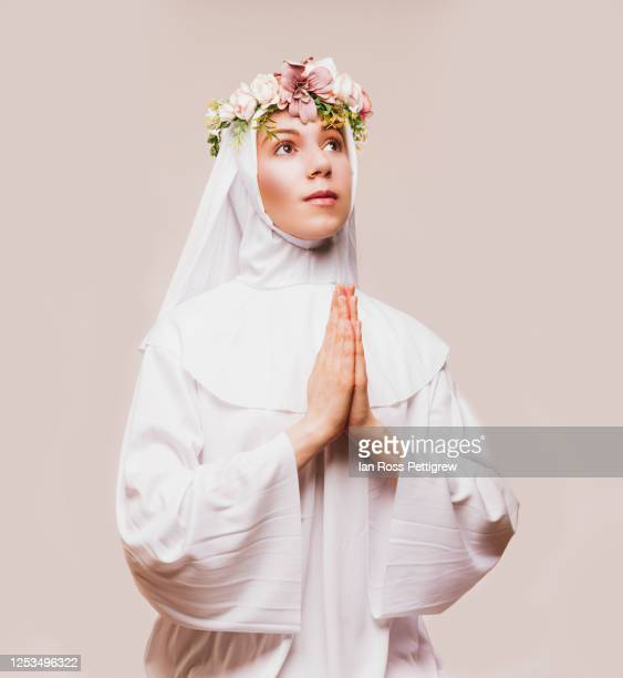 young girl catholic nun praying - nun stock pictures, royalty-free photos & images