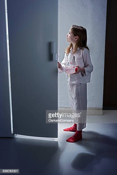Young Girl Caught Getting Late Night Snack From The Fridge