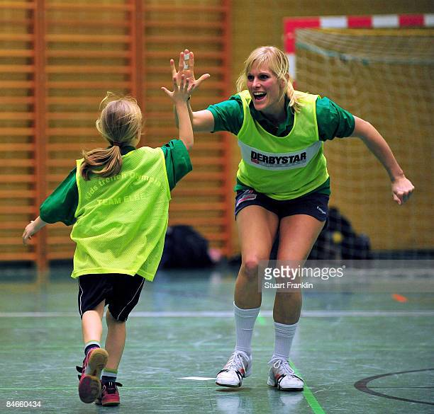 A young girl celebrates scoring a goal during a handball game as children meet Olympic competitors at the Hamburg Mannheimer headquarters on February...