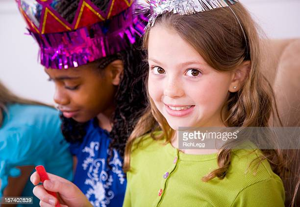young girl celebrating a birthday party - rich_legg stock pictures, royalty-free photos & images