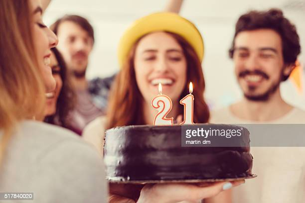 young girl celebrating her 21st birthday with friends - 20 24 years stock pictures, royalty-free photos & images