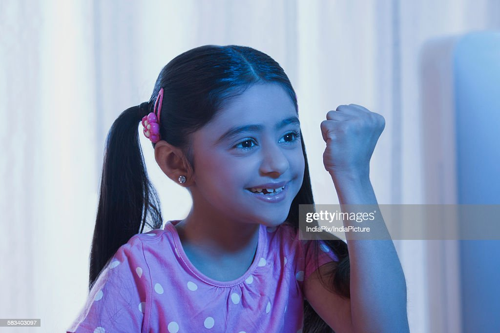 Young girl cheering : Stock Photo