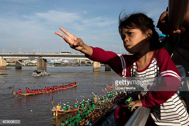 A young girl cheers on boat crews during their training on the morning of the first day of the Water Festival on November 13 2016 in Phnom Penh...