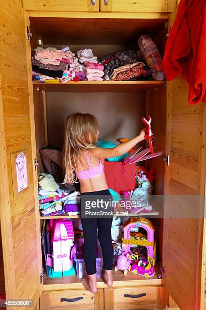 Young girl chooses clothes