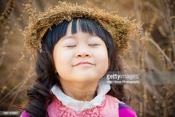 Young girl closes eyes and deep breath  in Autumn