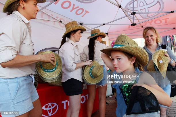 A young girl collects a cowboy hat during the Toyota Country Music Festival Tamworth on January 19 2018 in Tamworth Australia