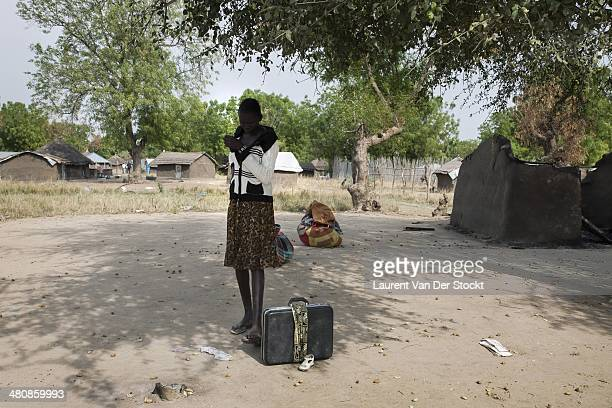 JANUARY 25 2014 A young girl come back to her burnedout district of bor to pick up some of his belongings before to leave again 200 km North of Juba...