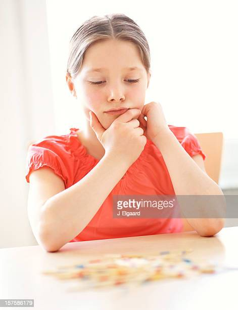 Young girl concentrating on a game of Mikado