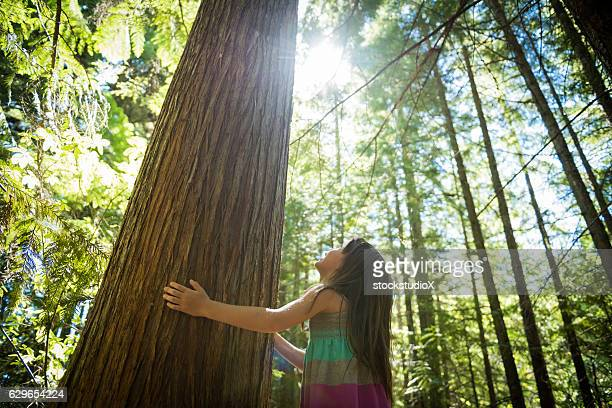 young girl connecting with nature - environmental conservation stock photos and pictures