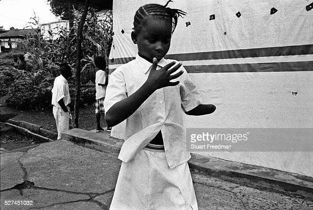 A young girl constantly counts her remaining fingers Murraytown Amputee Camp Freetown Sierra Leone 1999 Rebel forces the Revolutionary United Front...