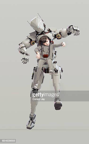 young girl controlling powerful robot