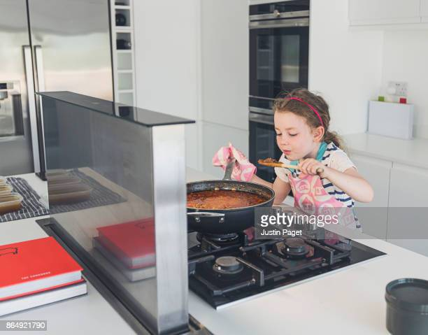 Young Girl Cooking in Modern Kitchen