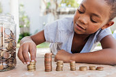 Young girl counting her coins.