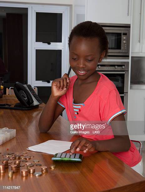 Young girl counting money, Johannesburg, South Africa